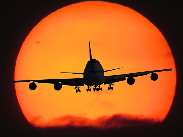 jet silhouette against sunset