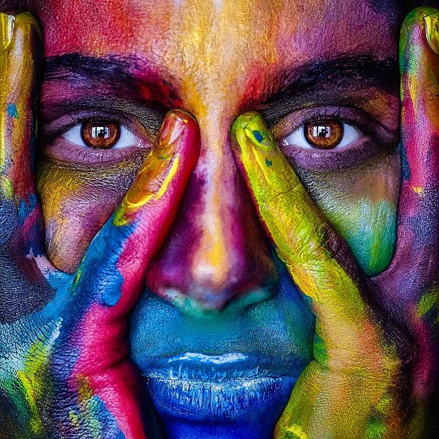women face with color paint