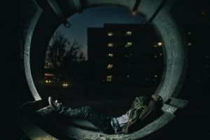 homeless youth in concrete pipe