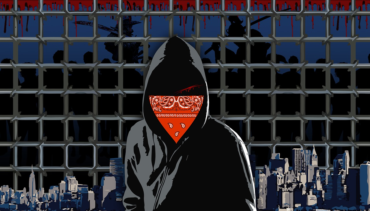 Faceless prisoner with city background.