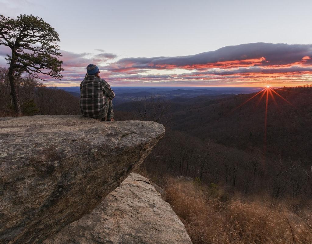 man enjoying beautiful and peaceful sunrise in nature