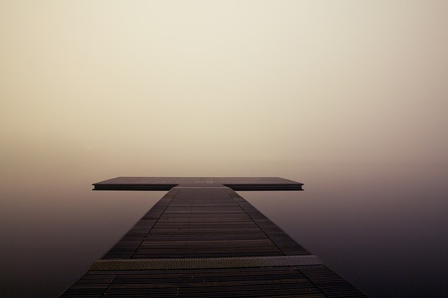 misty pier over water