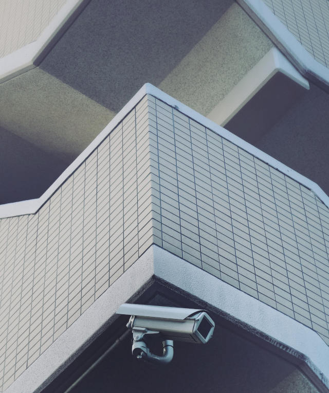Surveillance camera on corner of building