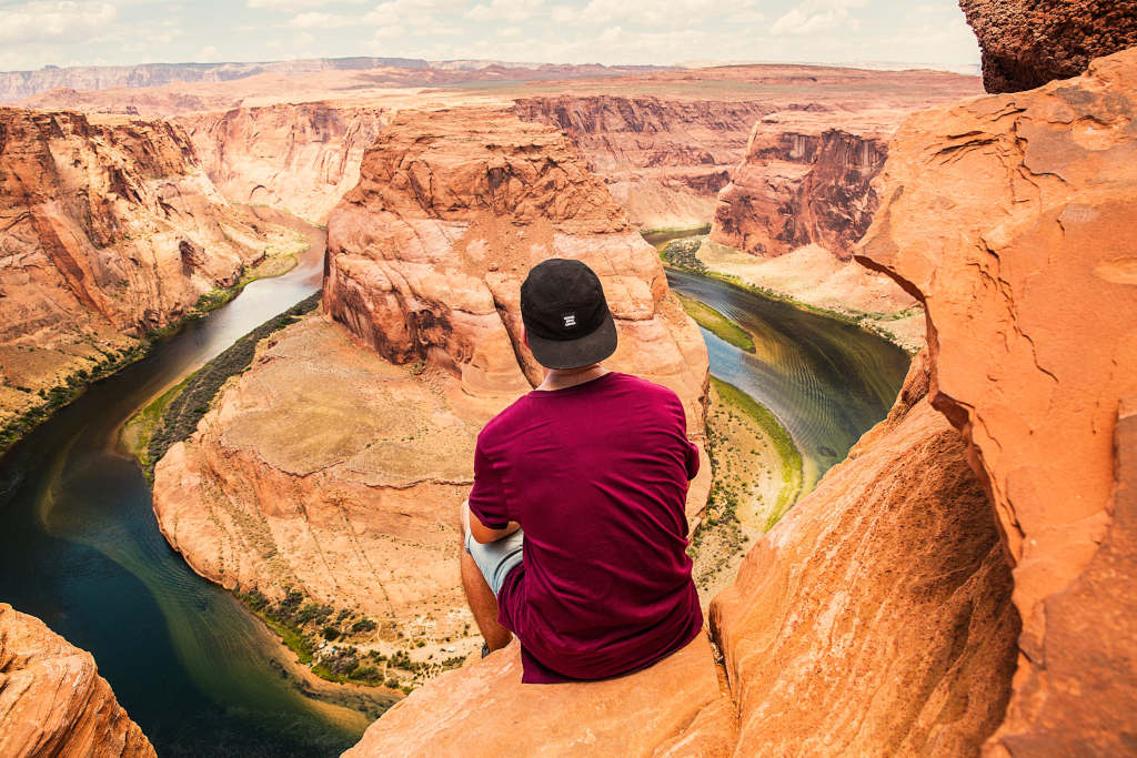 Man sitting over Grand Canyon