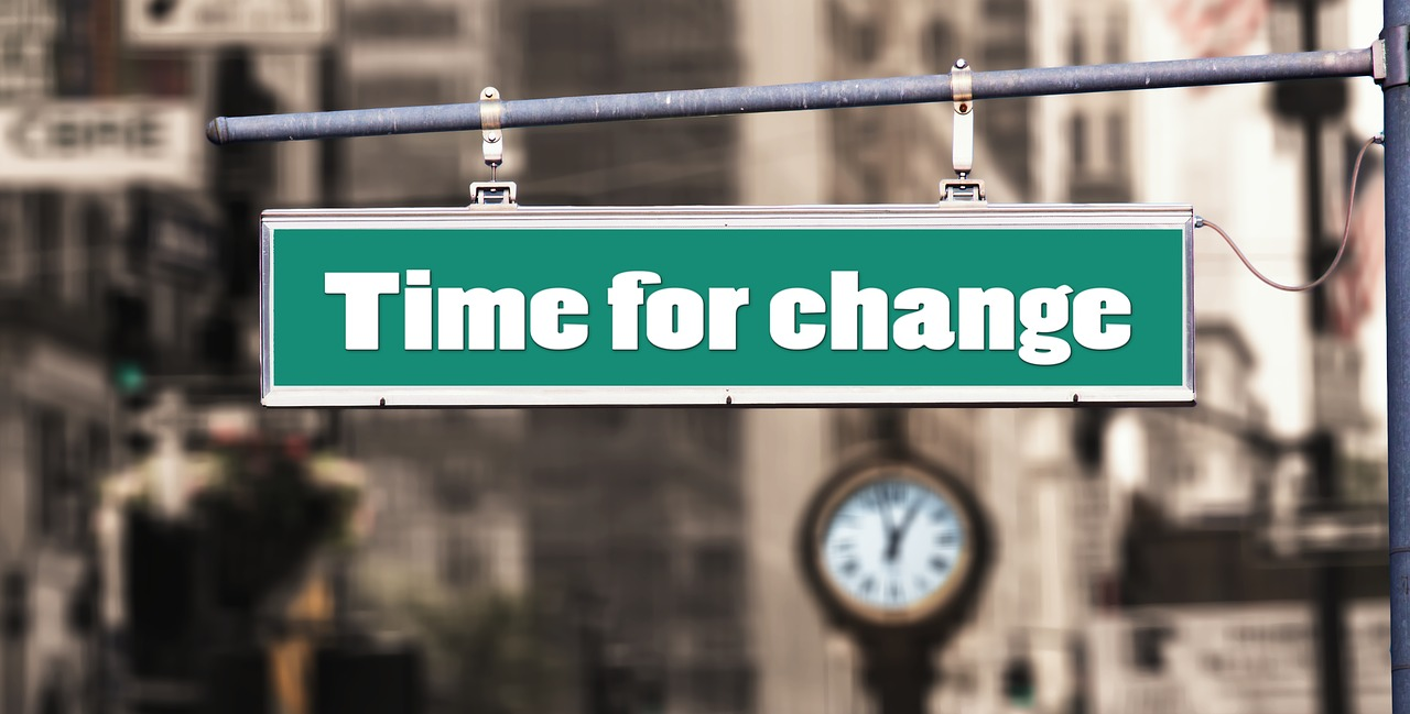 """Time for change"" street sign"